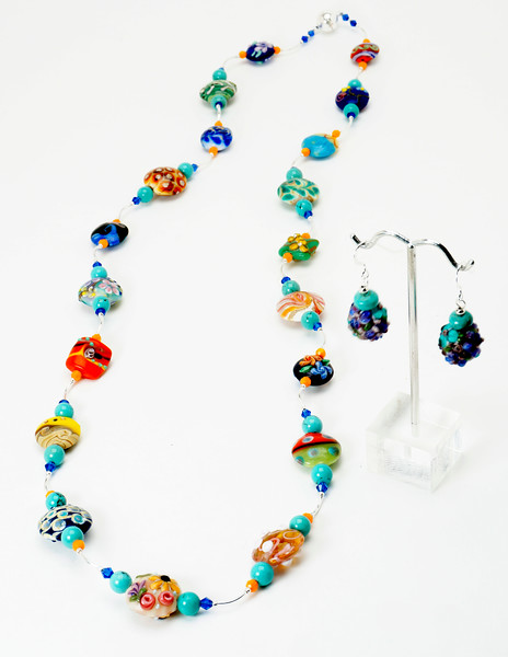 "#15019<br>Lamp glass, turquoise, crystal<br>And silver plated tubes.<br>Magnetic clasp.<br>Wear long @36"" or doubled at 18"".<br>Limited Edition. $175.00"
