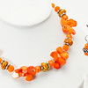 "#23418<br>Orange coral, pewter and agate mosaic beads.<br>Silver plated clasp<br>And 4"" extender chain.<br>17"" to 21"" Limited Edition.<br>Necklace $85.00<br>Earrings$27.00"