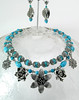 "#30712 <br>Pewter flowers on two strands of magnesite turquoise and pewter.<br>Silver plated clasp and 4"" extender chain. <br> Alice Bailey Designs signature tag.<br>Necklace 17.5  to 21.5"" Limited Edition $175.00<br>Earrings with pewter and surgical steel posts $26.00"