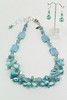 "#17212 <br>Amazonite, pearls, Peruvian opal, <br>dyed jade, angelite, crystal and glass. <br>Sterling silver &amp; blue topaz clasp<br> and 5"" silver extender chain. <br> Alice Bailey Designs signature tag.<br>Necklace  20"" to 24"" Limited Edition $275.00<br>Earrings with silver plated French clips $26.00"