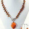 "#19519<br>Fire agate drop on<br>Leaf drilled bronze pearls.<br> Pewter toggle clasp.18""<br>Necklace $115.00 Earrings $27.00"