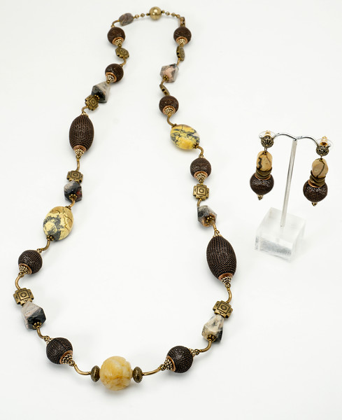 """#10718<br> Amazon turquoise, brown mesh,<br>Carved blond jade and Bronze tubes. <br>Antiqued bronze magnetic clasp.<br>36"""" or doubled at 18"""" Limited Edition.<br>Necklace $175.00 <br>Earrings wtih antiqued bronze filigree ear posts $31.00"""