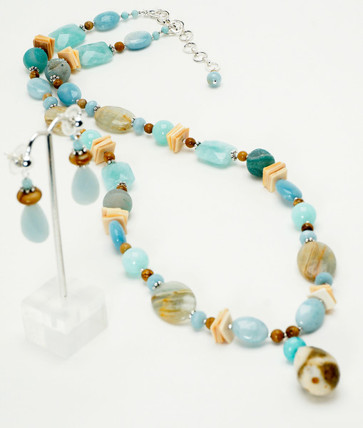 "#24118<br>Faceted jasper teardrop<br>On Amazonite, calcite, picture jasper<br>Blue agate druzy, chalcedony, pewter and shell.<br>Silver plated clasp<br>And 4"" extender chain.<br>30"" to 34"" Limited Edition.<br>Necklace $150.00<br>Earrings$29.00"