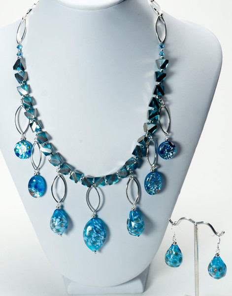 """#12420 Blown glass, millefiori glass<br> Swarovski crystal and cut-cube crystal.<br> Silver plated chain, clasp<br>And 4"""" extender chain.<br>17.5"""" to 21.5"""" One-of-a-kind.<br> Necklace $195.00<br>Earrings $32.00"""