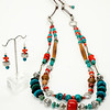 "#11819<br>Turquoise, coral, pewter, horn<br>Black turquoise, bronze and leather.<br>Silver plated clasp <br>And 4"" extender chain. <br>33"" to 37"" Limited Edition.<br>Necklace $195.00<br>Earrings $30.00"