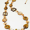 "#10819<br>Shell, pearls and bronze.<br>Gold plated clasp and 4"" extender chain.<br>$150.00"
