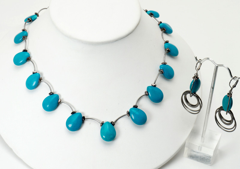 "#15317 <br>Magnesite turquoise briolettes <br>with hematite and gunmetal tubes. <br>Antiqued silver clasp and 4"" extender chain. <br>Necklace 16"" to 20"" Limited Edition $95.00<br>Earrings with gunmetal French clips 4$35.00"