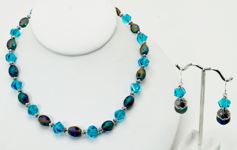 "#22118<br>Dichroic glass and turquoise crystal.<br>Silver plated clasp and 4"" extender chain.<br>16"" to 20"" Limited Edition.<br>Necklace $69.00<br>Earrings $27.00"