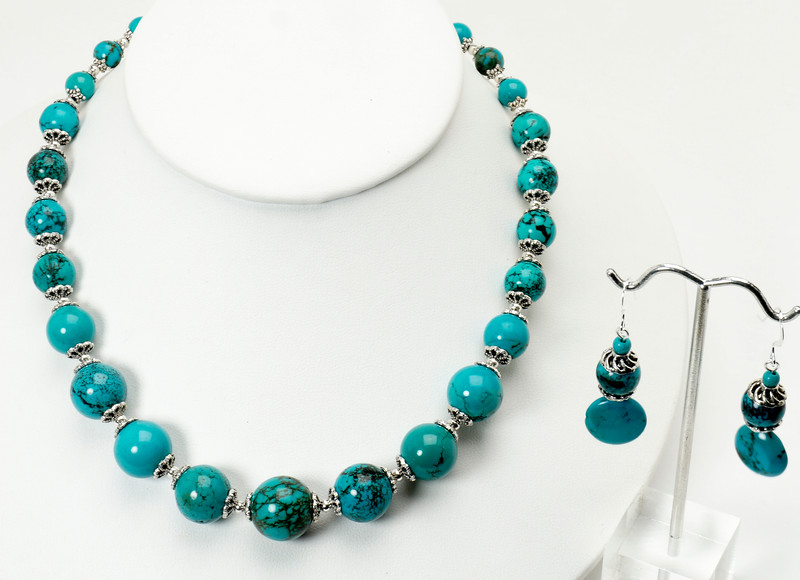 """#12418<br>Graduated turquoise and pewter.<br>Silver plated clasp and 4"""" extender chain.<br>17.5"""" to 21.5"""" Limited Edition. <br>Necklace $95.00<br>Earrings with silver ear wires $29.00"""