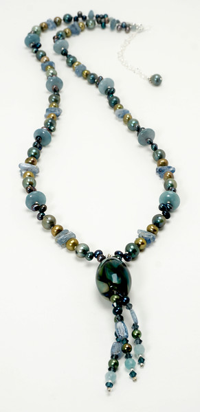 "#10220<br>Art glass, kyanite, <br>Pearls and angelite.<br>Silver plated clasp <br>And 4"" extender chain. <br>33"" to 37"" One-of-a-kind.<br>$295.00"
