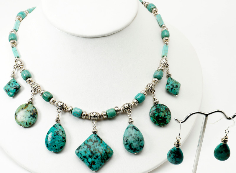 "#28616 Turquoise drops on pewter and magnesite turquoise.<br>Silver plated clasp and 4"" extender chain. <br>17"" to 21"" Limited Edition.<br><br><a href=""https://www.paypal.com/cgi-bin/webscr?cmd=_cart&add=1&business=alice@AliceBaileyDesigns.com&item_name=Alice%20Bailey%20Designs%20Item%20Number%2028616%20Necklace&item_number=28616&amount=%24140.00&return=http://www.paypal.com&cancel_return=http://www.paypal.com"" target=""_click"" class=""paypalbutton"">Purchase Necklace $140.00</a><br><br> <br><br><a href=""https://www.paypal.com/cgi-bin/webscr?cmd=_cart&add=1&business=alice@AliceBaileyDesigns.com&item_name=Alice%20Bailey%20Designs%20Item%20Number%2028616%20Earrings&item_number=28616&amount=%2432.00&return=http://www.paypal.com&cancel_return=http://www.paypal.com"" target=""_click"" class=""paypalbutton"">Purchase Earrings $32.00</a><br><br> <br><br><a href=""https://www.paypal.com/cgi-bin/webscr?cmd=_cart&add=1&business=alice@AliceBaileyDesigns.com&item_name=Alice%20Bailey%20Designs%20Item%20Number%2028616%20Earrings%20and%20Necklace&item_number=28616&amount=%24172.00&return=http://www.paypal.com&cancel_return=http://www.paypal.com"" target=""_click"" class=""paypalbutton"">Purchase Necklace and  Earrings $172.00</a><br><br> <br><br><br><br><img src=""http://ali.smugmug.com/Other/WebSiteImages/i-BftLFq2/0/O/paypal-175-50-O.jpg""><br><font class=""captionfooter"">Free Shipment on all Orders</font>"