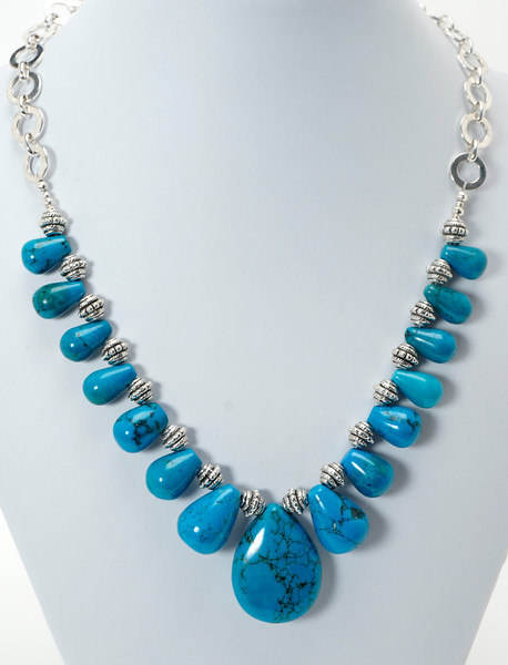 "#10820<br>Graduated turquoise briolettes <br>And pewter.<br>Silver plated clasp, chain <br>And 4"" extender chain. <br>17"" to 21"" Limited Edition.<br>$95.00"