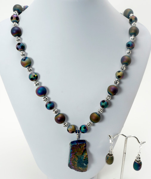 """#11020<br>Rainbow hematite drop<br>On quartz druzy and pewter.<br>Silver plated clasp <br>And 4"""" extender chain. <br>21"""" to 25"""" Limited Edition.<br>Necklace $115.00<br>Earrings $32.00"""