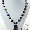 "#11020<br>Rainbow hematite drop<br>On quartz druzy and pewter.<br>Silver plated clasp <br>And 4"" extender chain. <br>21"" to 25"" Limited Edition.<br>Necklace $115.00<br>Earrings $32.00"