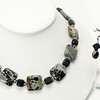 "#10520<br>Paintbrush jasper<br>Matte onyx and pewter.<br>Silver plated clasp <br>And 4"" extender chain. <br>18"" to 22"" Limited Edition.<br>Necklace $65.00<br>Earrings $27.00"