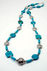 "#18918<br>Turquoise and pewter.<br>Silver magnetic clasp.<br>37"" or doubled at 18"". <br>Limited Edition. <br>Necklace $150.00"