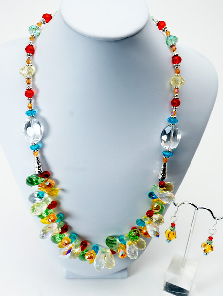 """#20817 <br>Multi-colored crystal, glass and pewter. <br>Silver plated clasp and 5"""" built-in extender chain. <br>Necklace 21.5"""" to 26"""" Limited Edition. $150.00<br>Faceted citrine and crystal earrings with sterling silver ear wires $30.00"""
