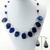 "#13319<br>Lapis and silver plated tubes.<br>Silver plated clasp and 4"" extender chain.<br>17"" to 21"" Limited Edition.<br>Necklace $150.00<br>Earrings $29.00"