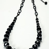 "#12820<br>Graduated black onyx and pewter.<br>Nite black chain, clasp<br>And 4"" extender chain.<br>27.5"" to 32.5"" Limited Edition.<br>Necklace $135.00"