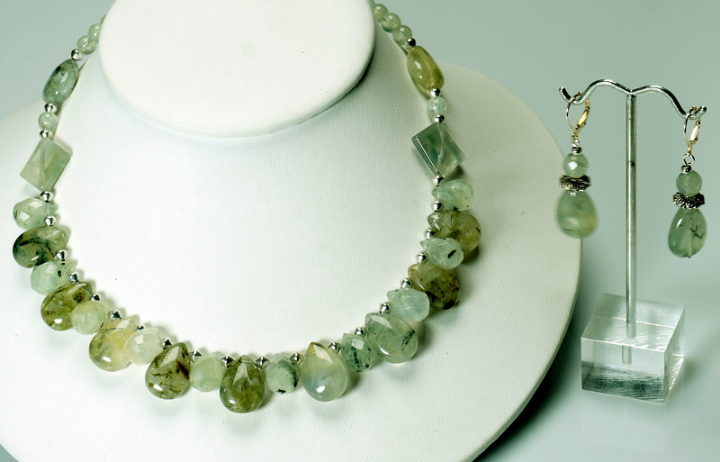 "#19419<br>Natural prehinite quartz and pewter.<br>Silver plated clasp and 4"" extender chain.<br>17"" to 21"" Limited Edition.<br>Necklace $125.00 <br>Earrings $30.00"