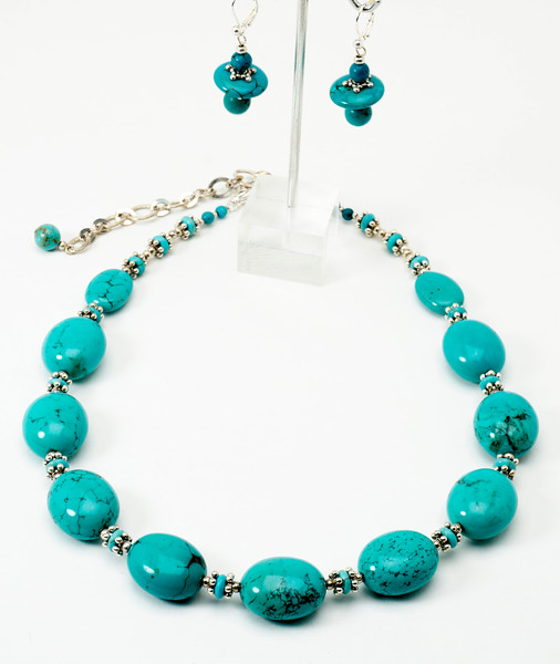 "#28516 <br>Turquoise nuggets and heishi with pewter.<br>Silver plated clasp and 4"" extender chain. <br>Necklace 17"" to 21"" Limited Edition $95.00<br>Earrings with silver plated French clips $28.00"