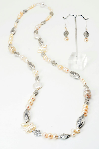 "#14319<br> Natural peach pearls and pewter.<br>Magnetic clasp. <br> Wear long @36"" or doubled @18""<br>Limited Edition. Necklace $150.00<br> Earrings $27.00"