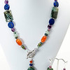 "#19319 <br>Green Zebra agate drop, carnelian, <br>Lapis, green aventurine, jade and amethyst. <br>Pewter toggle clap.<br>18"" Limited Edition.<br>Necklace $95.00 Earrings $28.00"