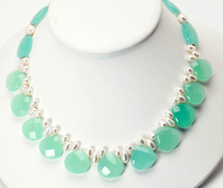 """#14219<br>Faceted aqua glass <br>And white pearls.<br> Silver plated clasp and 4"""" extender chain.<br>16"""" to 20"""" Limited Edition.<br>Necklace $125.00<br>Earrings $28.00"""