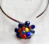 #17919N Multi-colored crystal flower<br>On silver plated neck wire.<br>One-of-a-kind.<br>$135.00