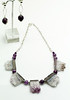 "#14815<br> Amethyst slices with<br>Faceted Amethyst and sterling silver chain.<br>18"" or less. One-of-a-kind.<br> Necklace $150.00<br> Earrings with silver plated ear posts $29.00"