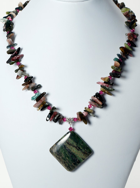 """#14820 <br>Zebra agate drop<br>On tourmaline and Swarovski crystal.<br>Silver plated clasp<br>And 4"""" extender chain.<br>17"""" to 21"""" Limited Edition.<br>$125.00"""