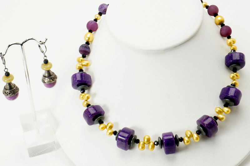 "#13719<br>Purple color-treated jade<br>Pearls, hematite and crystal.<br>Nite black clasp and 4"" extender chain.<br>17"" to 21"" One-of-a-kind.<br>Necklace $95.00<br>Earrings $30.00"