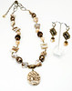 "#15018<br>Graphic feldspar drop<br>On shell, shell pearl, bronze mesh and tubes.<br>Antiqued bronze clasp and 4"" extender chain. <br>28"" to 32"" Limited Edition. <br>Necklace $150.00<br>Earrings with antiqued bronze French clips $28.00"