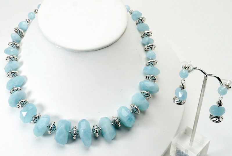 "#13817 <br>Grade A graduated aqua marine and pewter.<br> Silver plated clasp and 4"" extender chain. <br>Alice Bailey Designs signature tag. <br>Necklace 18"" to 22"" Limited Edition $225.00<br>Earrings with aqua marine and sterling silver ear posts $37.00<br> Note: natural stones will vary slightly."