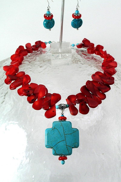 "#11913 <br>Magnesite turquoise cross on red coral.<br> Silver plated clasp and 4"" extender chain. <br>Alice Bailey Designs signature tag.<br>Necklace 16"" to 20"" Limited Edition $115.00<br>Earrings with sterling silver ear wires $28.00"