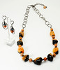 "#17017<br> Burnt orange and black fire agate and hematite <br>with gunmetal clasp and chain. <br>Necklace 28"" to 31"" Limited Edition $115.00<br>Earrings with gunmetal French clips $29.00"