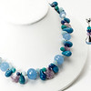 """#23718<br>Graduated, faceted periwinkle blue chalcedony,<br>Denim magnesite, sodalite,Russian amazonite,<br> Green aventurine, crazy lace agate and color-treated jade.<br>Silver plated clasp<br>And 4"""" extender chain.<br>18"""" to 22"""" Limited Edition.<br>Necklace $135.00<br>Earrings$29.00"""