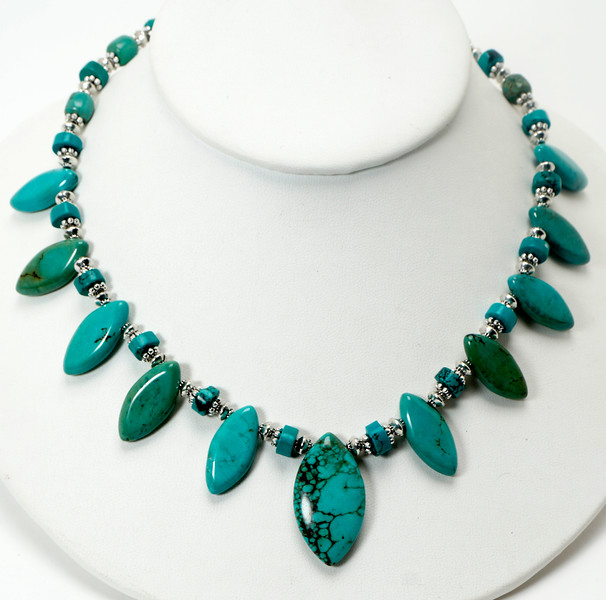 "#10720<br>Turquoise and magnesite turquoise.<br>Silver plated clasp <br>And 4"" extender chain. <br>17.5"" to 21.5"" Limited Edition.<br>$95.00"