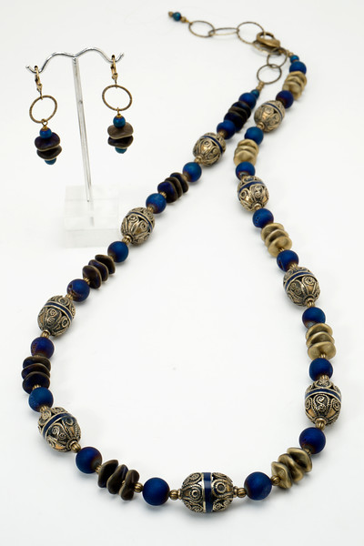 """#21818<br>Antiqued silver filigree, <br>Cobalt quartz, glass<br>And antiqued bronze.<br>Antiqued bronze clasp and chain.<br>30"""" to 33.5"""" Limited Edition.<br>Necklace $135.00<br>Earrings with antiqued bronze French clips $29.00"""