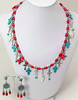 "#18515 <br>Coral, turquoise, sterling silver  and <br>pearl crosses with pewter bails. <br>Silver plated clasp and 4"" extender chain.<br> Necklace 17.5"" to 21.5"" Limited Edition $175.00<br>Earrings with pewter and surgical steel posts $35.00"
