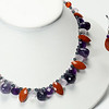 "#13720<br>Faceted sodalite, amethyst<br>And jasper briolettes.<br>Silver plated clasp<br>And 4"" extender chain.<br>17"" to 21"" Limited Edition.<br>Necklace $95.00<br>Earrings $29.00"