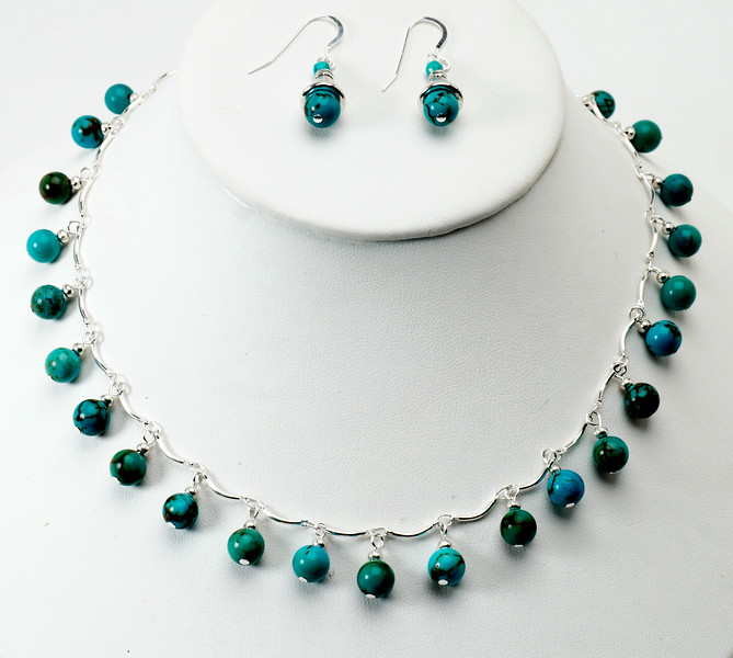 "#14417 <br>Turquoise drops on delicate silver plated chain.<br>Silver plated clasp and 4"" extender chain. <br>Necklace 16"" to 20"" Limited Edition $95.00<br>Earrings with sterling silver ear wires $26.00"