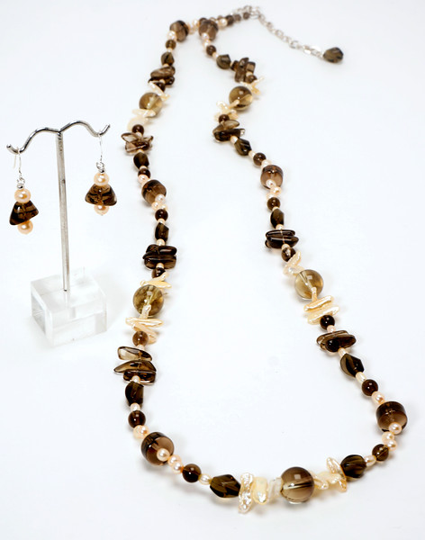 """#10620<br>Smokey quartz and peach pearls<br>Silver plated clasp <br>And 4"""" extender chain. <br>37"""" or doubled at 18"""" Limited Edition.<br>Necklace $225.00<br>Earrings $29.00"""