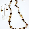 "#10620<br>Smokey quartz and peach pearls<br>Silver plated clasp <br>And 4"" extender chain. <br>37"" or doubled at 18"" Limited Edition.<br>Necklace $225.00<br>Earrings $29.00"