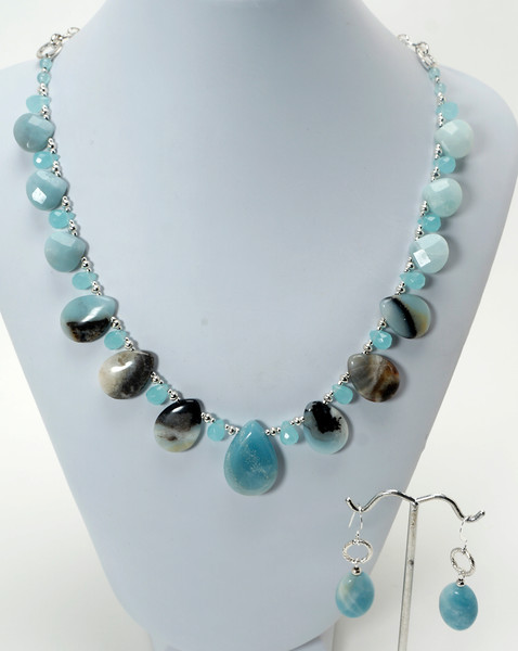 """#11220<br>Amazonite and faceted aqua glass briolettes.<br>Silver plated chain,clasp <br>And 4"""" extender chain. <br>18"""" to 22"""" Limited Edition.<br>Necklace $100.00<br>Earrings $28.00"""