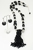 "#16017 <br>Glass beaded tassel on black onyx, <br>mesh, glass and glass pearls. <br> Silver plated clasp and 4"" extender chain.<br>Necklace  35"" to 39"" Limited Edition $150.00<br>Earrings with silver plated Frenchc lips $26.00"