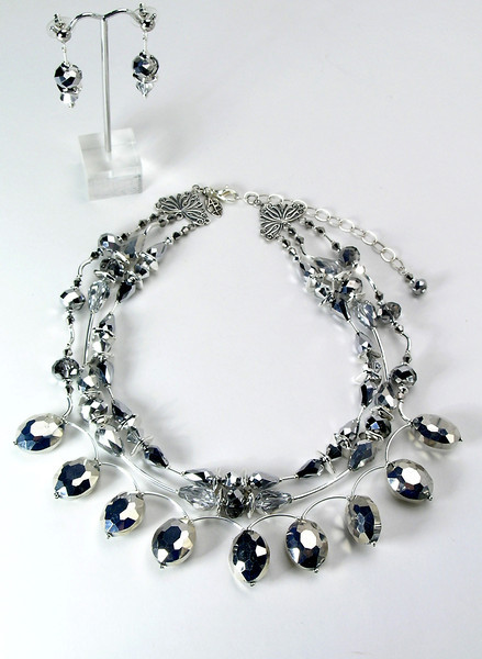 """#15414 <br>Three strands of silver metallic crystal and silver plated tubes.<br> Silver plated clasp and 4"""" extender chain.<br> Alice Bailey Designs signature tag. <br>Necklace 16"""" to 20"""" Limited Edition $195.00<br>Earrings with silver plated posts $26.00"""