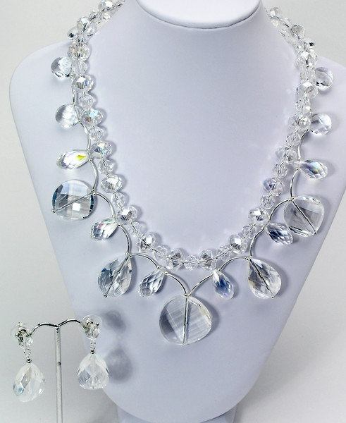 "#17015<br>Two strand of clear crystal <br>With silver plated tubes,<br>Clasp and 4"" extender chain. <br>17.5"" to 21.5"" One-of-a-kind.<br>Necklace $175.00<br>Earrings with crystal and sterling posts $32.00"