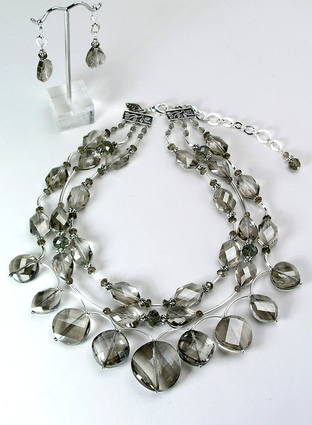 "#15314 <br>Three strands of smokey crystal, smokey quartz, <br>pewter and silver plated tubes. <br>Silver plated clasp and 4"" extender chain.<br>Alice Bailey Designs signature tag. <br>Necklace 16.5"" to 20.5"" Limited Edition $195.00<br>Earrigns with silver plated French clips $27.00"