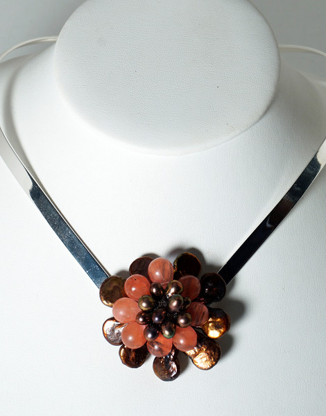 """#18319<br>Bronze pearl and strawberry quartz flower<br>On silver plated neck wire. <br>16"""" One-of-a-kind.<br>$135.00"""